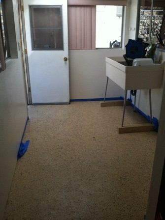 Here is the room before with the tan garage coating.